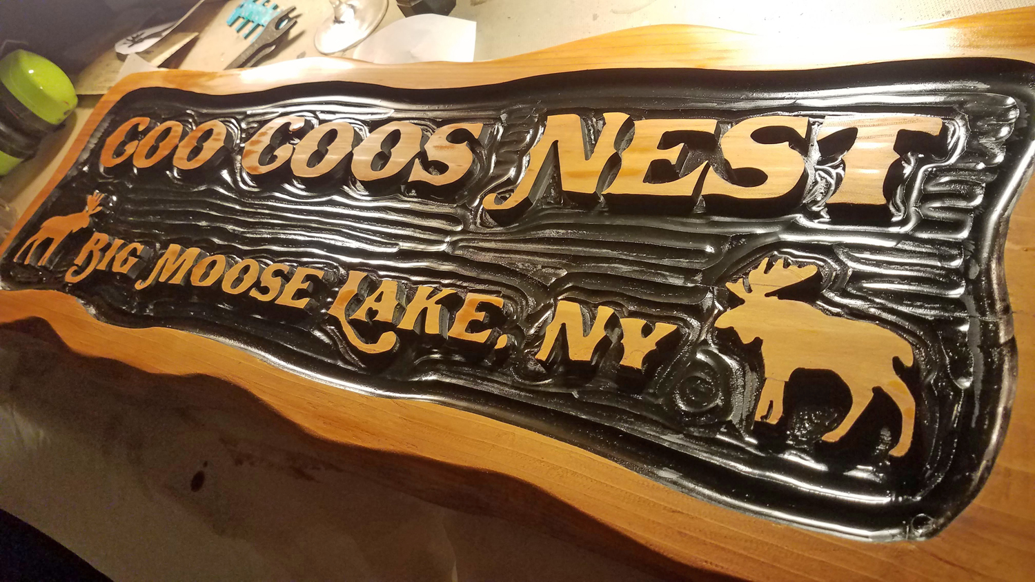 Jim Thomson of Adirondack Jim's created a sign for the Coo Coos Nest using premium western cedar and implementing the shop's signature relief carving.