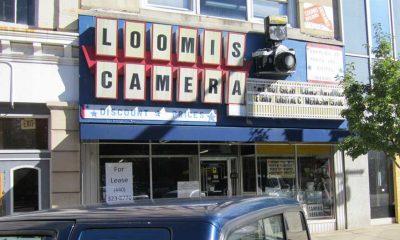 American Sign Museum restores storefront camera shop signage.
