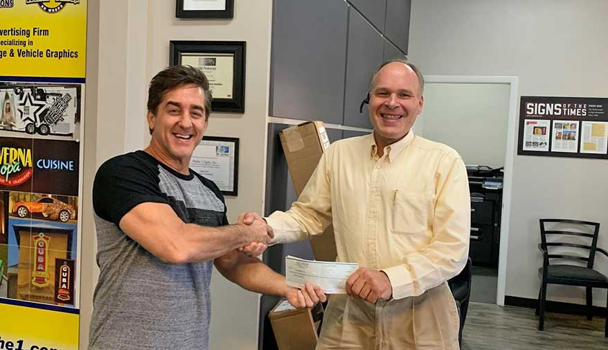Dale hands over the deposit for his long sought-after new building