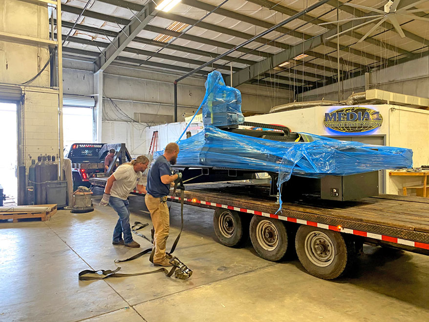 Moving Media 1/Wrap This' heavy-duty equipment required big wheels and careful planning.