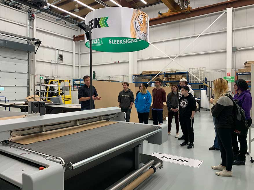 Sleek (Regin, SK, Canada) shows students the ropes during a recent Sign Manufacturing Day.