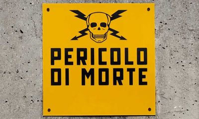 "This Italian sign, which translates to ""danger of death,"" speaks the universal language of hazard signs: bright yellow paired with a bold black font, adorned with a skull and bolts of electricity."