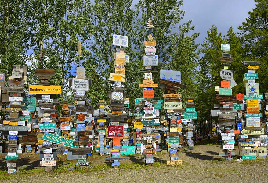 The Sign Post Forest encourages visitors to add their own signs.