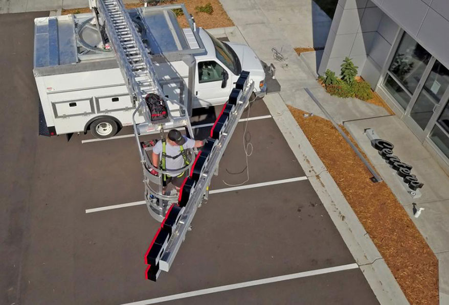 Improvements in aerial equipment bolster safety and enable sign mechanics to work more efficiently.