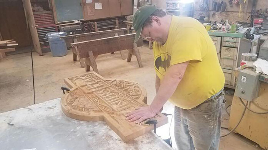 Gary Lyons working on Valley Sign sign