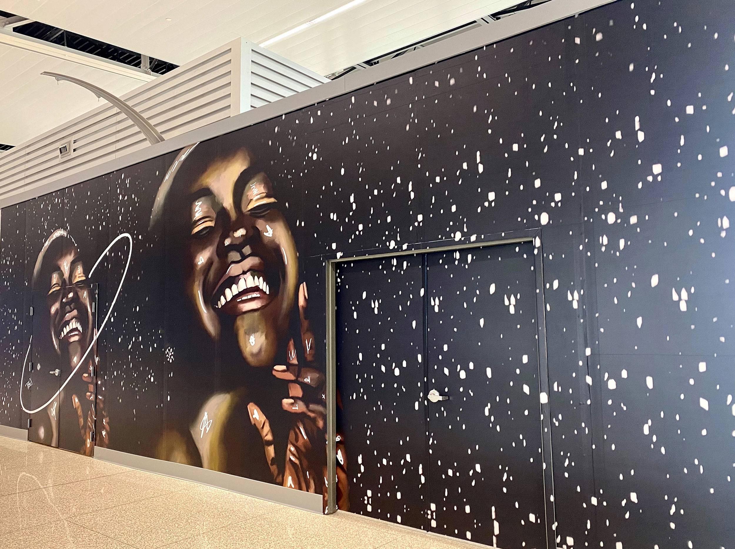 For the Swish project in Indianapolis, Repro Graphix digitally printed the work by local creatives like Boxx the Artist (right) and Tasha Beckwith (below), and installed it at the Indianapolis International Airport.