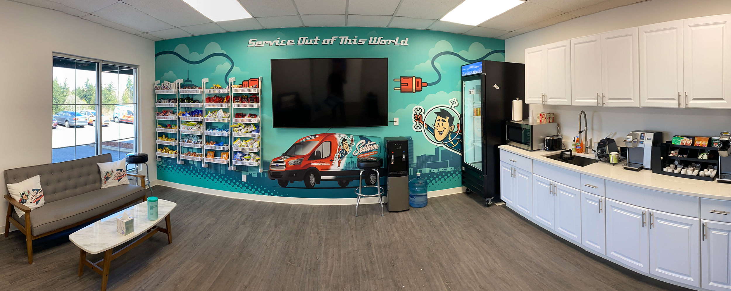 """Graphics used on the fleet trucks as well as images of trucks themselves bring outside branding inside .Taglines such as Seatown's """"Service Out of This World"""" make good candidates for wall-wrap copy."""